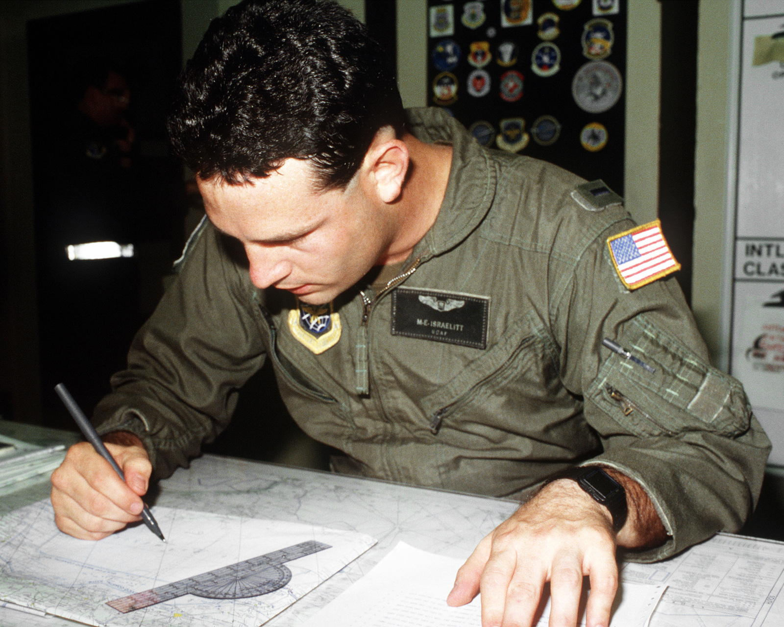 1LT Mark Israelitt, a navigator with the 53rd Weather Reconnaissance Squadron, plans the course that his WC-130H Hercules aircraft will take across the Gulf of Mexico as it travels into Hurricane Gilbert to gather meteorological data