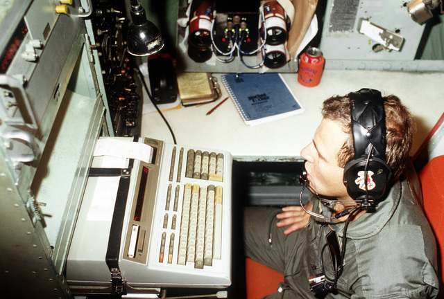 A1C Timothy Fields of the 53rd Weather Reconnaissance Squadron readies an computer aboard a WC-130H Hercules aircraft to receive information that will be transmitted by wind sondes dropped into Hurricane Gilbert. The aircraft is flying into the hurricane