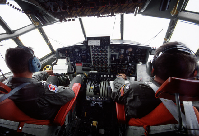 The pilot and co-pilot of a WC-130H Hercules guide their aircraft into a cloud bank after flying through the eye of Hurricane Gilbert to collect meteorological data. The aircraft and crew are assigned to the 53rd Weather Reconnaissance Squadron based at K