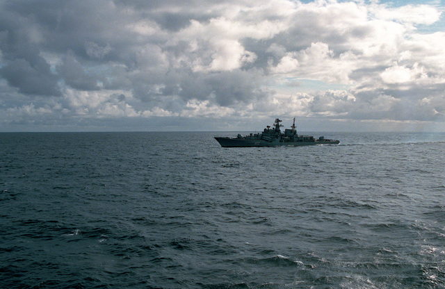 The replenishment oiler USS MILWAUKEE (AOR 2) steams alongside the aircraft carrier USS FORRESTAL (CV 59) as it conducts an underway replenishment of the carrier during the allied forces exercise TEAM WORK '88