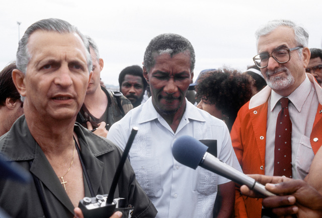 After accepting the first shipment of U.S.-provided supplies, Jamaican prime minister Edward Seaga, left, speaks to reporters about his nation's response to the devastation caused by Hurricane Gilbert, a powerful storm that hit the island on September 12
