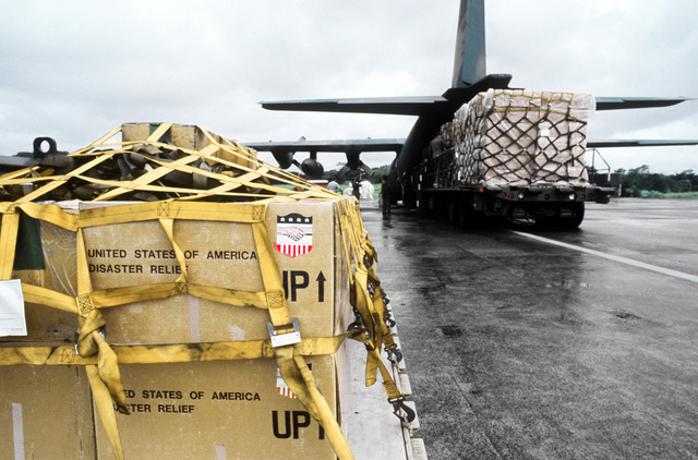 American disaster relief supplies such as chain saws, plastic sheets, tents and water containers are loaded aboard a C-130 Hercules aircraft of the 50th Tactical Airlift Squadron. The supplies will be flown to Jamaica, where Hurricane Gilbert caused exten