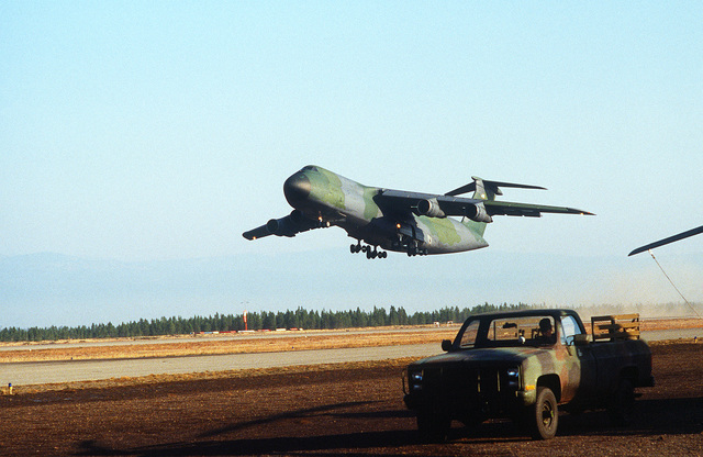 An Air Force C-5A Galaxy transport aircraft from the 60th Military Airlift Wing lifts off of the runway for its return flight to Travis Air Force Base, Calif. The aircraft had brought Marines of the 5th Marine Regiment from Camp Pendleton, Calif., to the