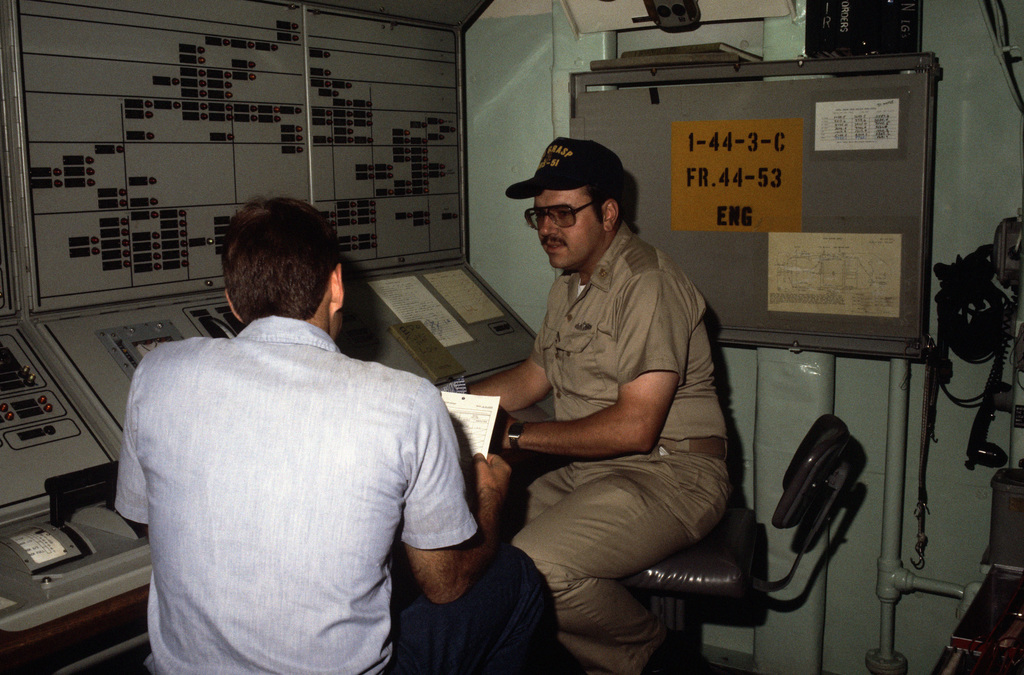 Mess Management SPECIALIST First Class (MS1) Joseph L. Penca, supply department career counselor aboard the salvage ship USS GRASP (ARS 51), counsels SEAMAN Apprentice (SA) Chris Griggs on his performance using a professional profile worksheet