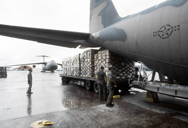 Several pallets of disaster relief supplies are moved into position at the rear of a C-130 Hercules aircraft of the 50th Tactical Airlift Squadron. The supplies will be flown to Jamaica, where they will be used to help residents recover from the destructi