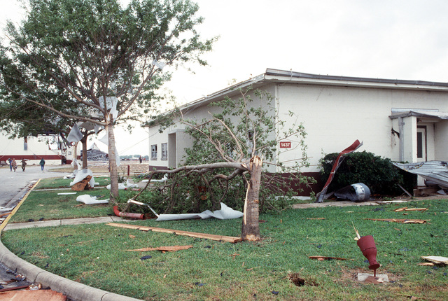 An exterior view of Building 1437, the mobility computer center at the San Antonio Air Logistics Center, in the aftermath of Hurricane Gilbert