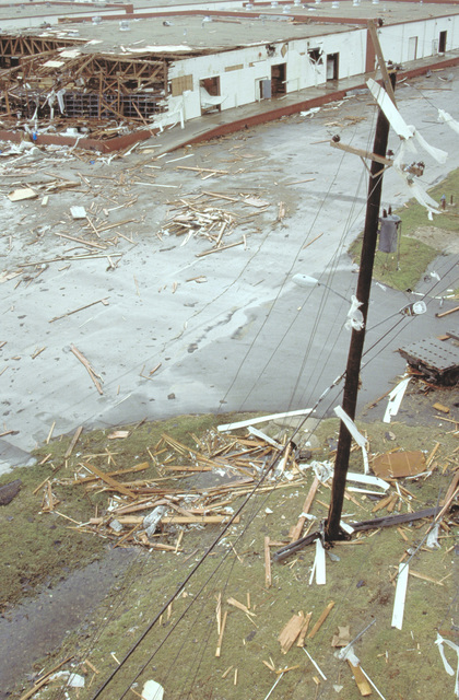 An overview of a damaged warehouse and downed power lines at the San Antionio air Logistics Center, in the aftermath of Hurricane Gilbert