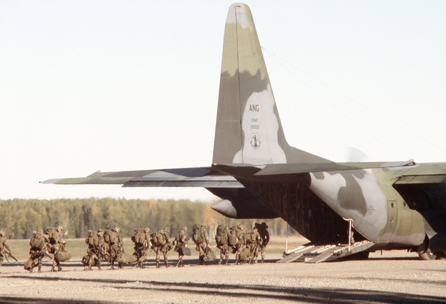 A C-130 Hercules aircraft of the Alaska Air National Guard, 176th Composite Group, is loaded wih personnel and equipment at Malamute Drop Zone during combined Army-Air Force live fire exercises (CALFEX IV) at the Yukon Command Training Site
