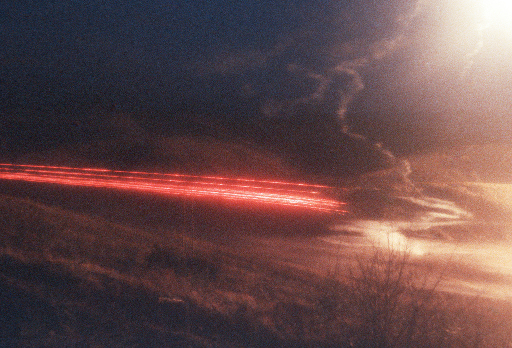 Night fire illuminates the sky during combined Army-Air Force live fire Exercises (CALFEX IV) at the Yukon Command Training Site