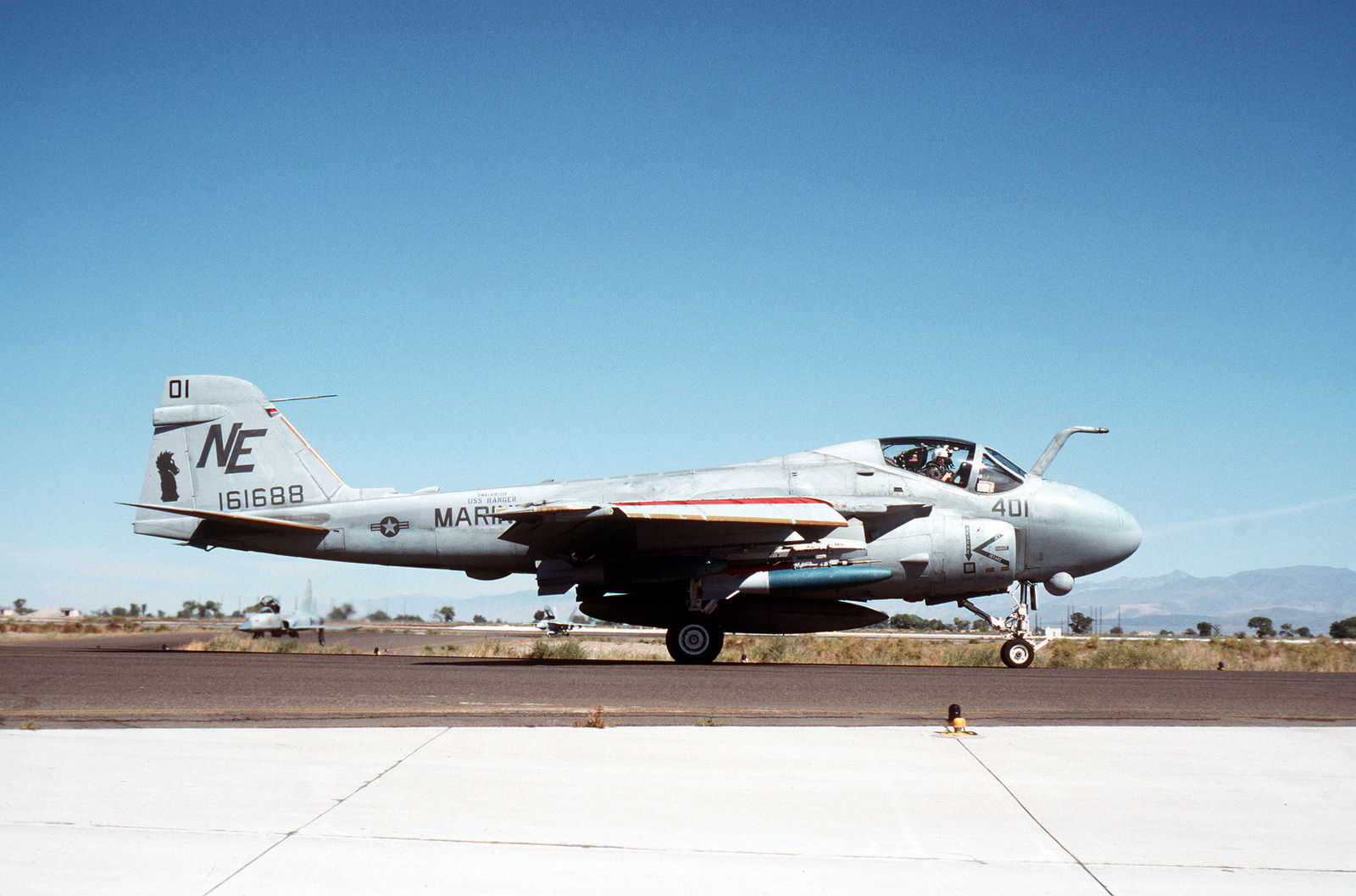 A right side view of a Marine All-Weather Attack Squadron 121 (VMA(AW)-121) A-6E Intruder aircraft preparing for takeoff