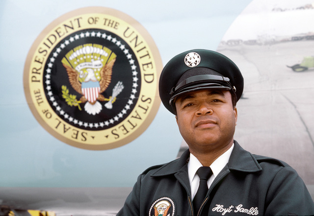 CHIEF MASTER SGT. Hoyt Gamble, 1776th Security Police Squadron, Special Air Missions Unit, stands in front of Air Force One during security operations