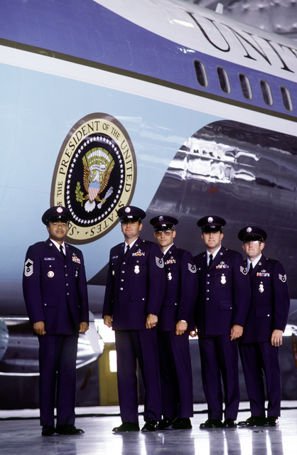Members of the 1776th Security Police Squadron, Special Air Missions Unit, CHIEF MASTER SGT. Hoyt Gamble, Left; MASTER SGT. Mike Wells; TECH SGT. Mike Herring; STAFF SGT. Grover Hamilton and STAFF SGT. Mark Martini, stand at attention in front of Air Force One