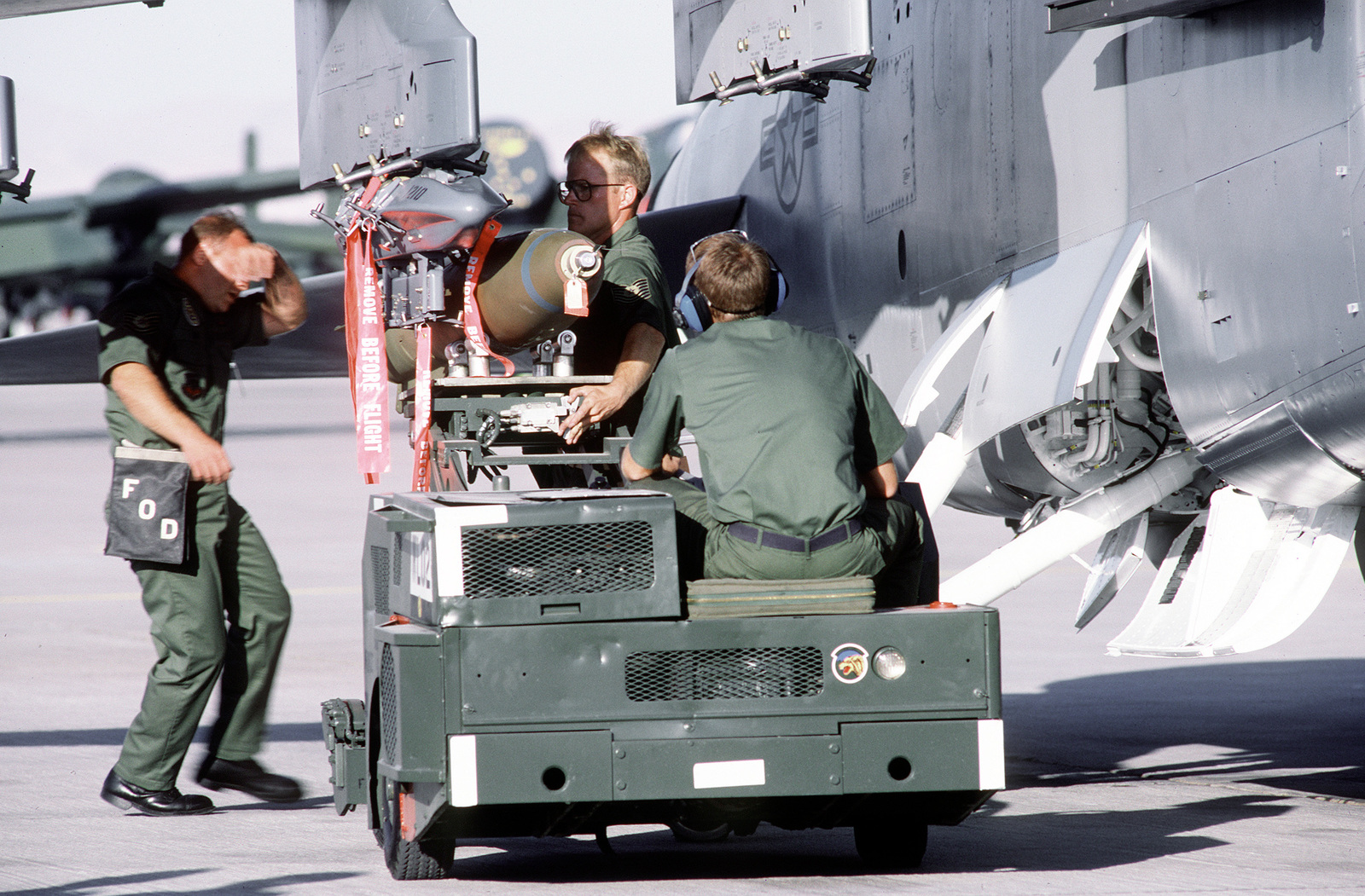 Colorado Air National Guard munitions crew members prepare Mark 82 high-drag bombs to be used in A-7 Corsair II aircraft missions during Gunsmoke '87, an Air Force-wide tactical Air Command and hosted by the Tactical Fighter Weapons Center at Nellis