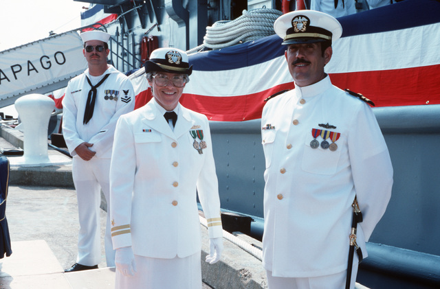 Lieutenant (LT) Susan J. Trucken-Schreck, executive officer of the fleet tug USS PAPAGO (ATF 160), poses with another officer during the ship's recommissioning ceremony at Pier 57