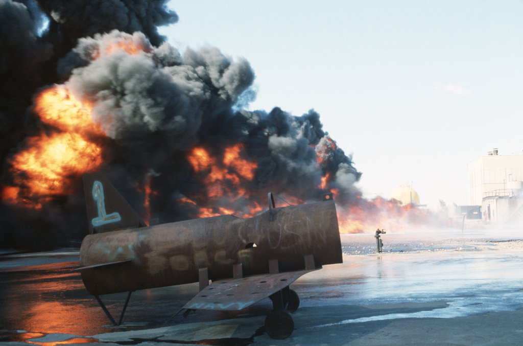 A blaze engulfs a simulated aircraft during an exercise at the Norfolk Fleet Training Center Firefighting School