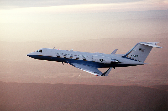 A left side view of a C-20A aircraft from the 99th Military Airlift Squadron in-flight near the base. The C-20A, built by Gulfstream Aerospace, is a modified Gulfstream III that serves as a staff transport