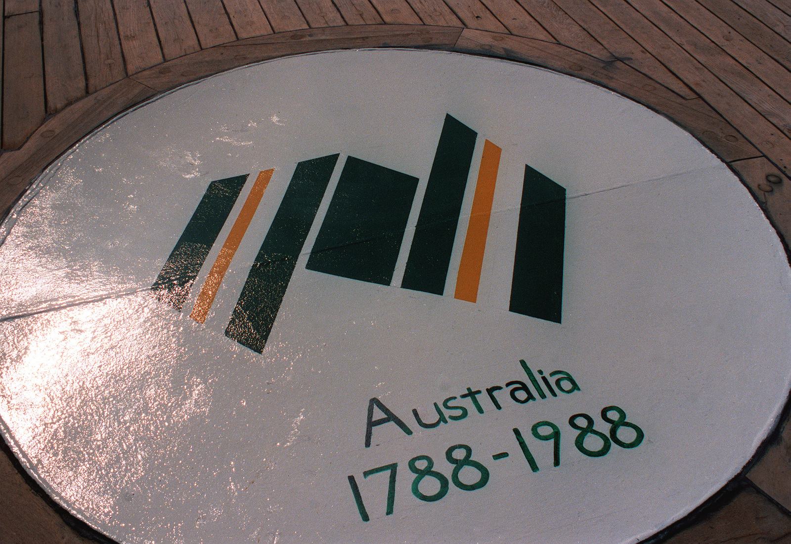 A view of the Australian bicentennial emblem painted on the metal plate covering one of the former forward 40mm gun mount areas aboard the battleship USS JERSEY (BB-62). Exact Date Shot Unknown