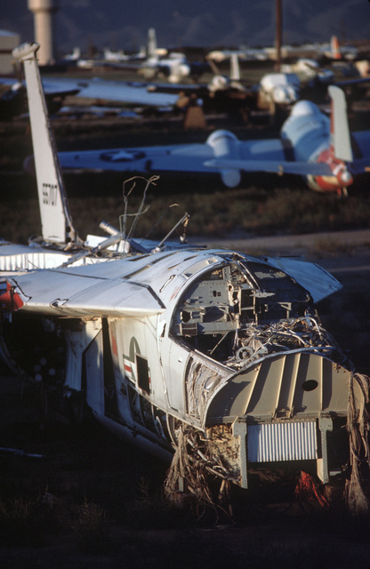 The picked over remnants of an F-111 aircraft lie on the desert floor in the late afternoon sun at the Aerospace Maintenance and Regeneration Center. More that 2,500 aircraft from all services are stored at the center, only a small percentage of which are
