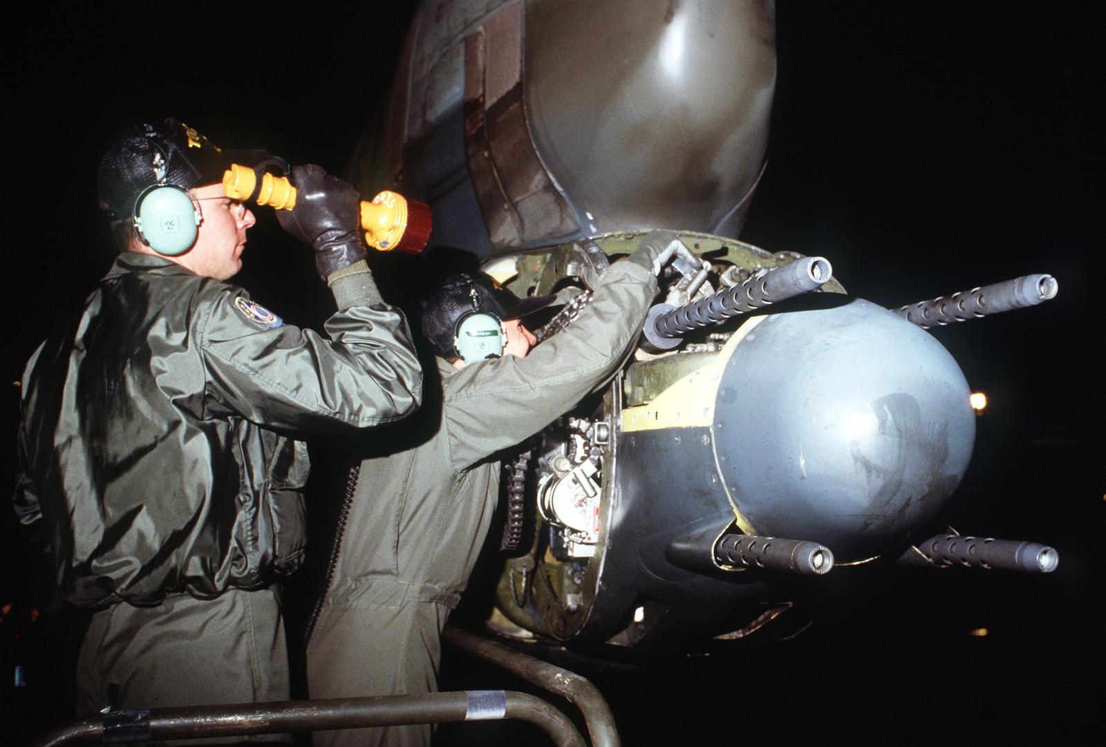 aircrewmen-inspect-the-50-caliber-machin