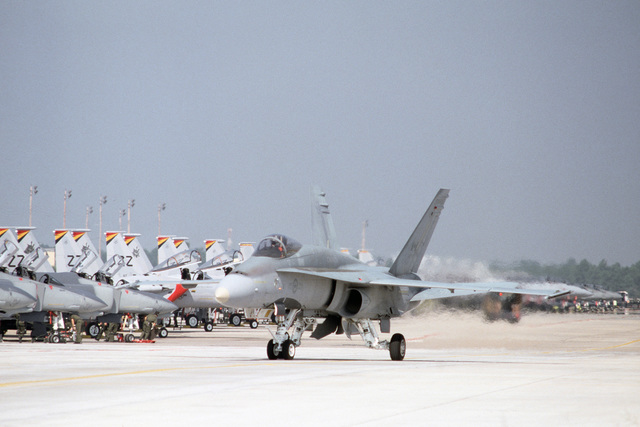 A Canadian air force CF-18 Hornet aircraft taxis on the runway after completing a mission during Exercise WILLIAM TELL 88