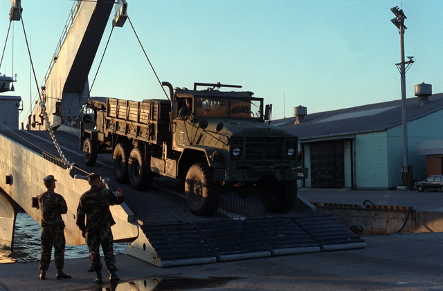 Members of Btry. B, 1ST Bn., 12th Marines, unload a M-923 5-ton truck for the joint Korean-U.S. Exercise Bear Hunt '88 off of a ship