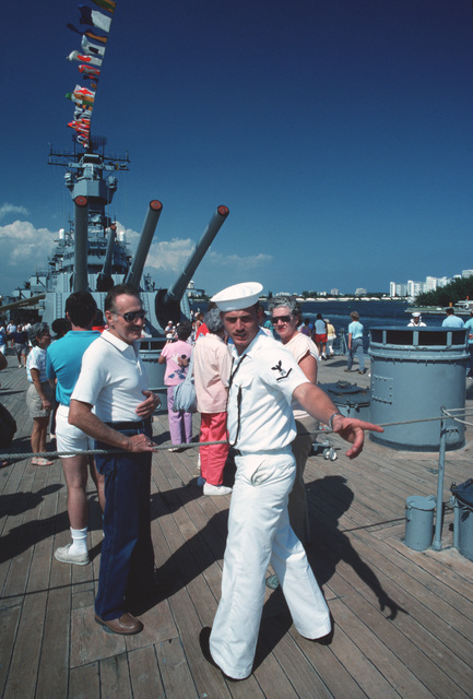A PETTY Officer Third Class (PO3) responds to questions from curious visitors aboard the battleship USS IOWA (BB 61).  The IOWA is among eight US Navy warships here participating in Navy Appreciation Week sponsored by the Navy League