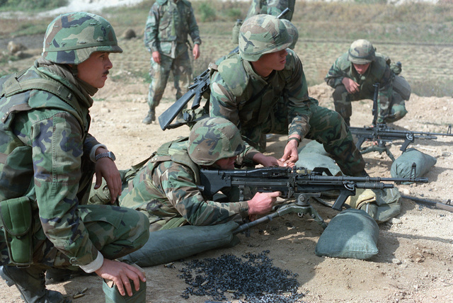 Members of Btry. K, 4th Bn., 12th Marines, practice firing an M-60 lightweight machine gun during the joint Korean-U.S. Exercise Bear Hunt '88