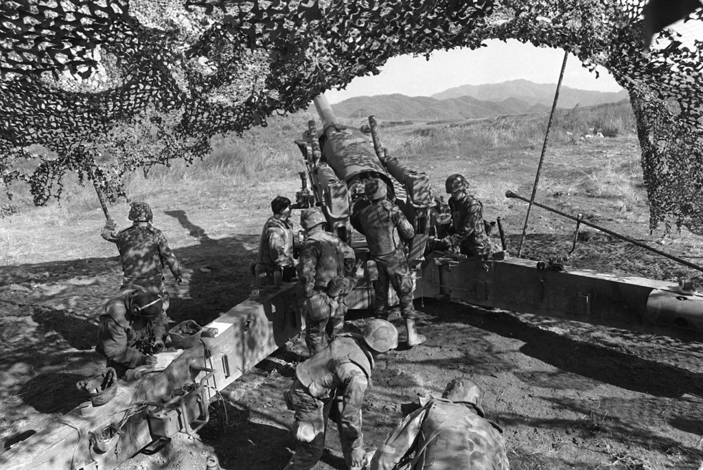 Members of Btry. L, 4th Bn., 12th Marines, conduct target practice with a M-198 155mm howitzer during the joint Korean-U.S. Exercise Bear Hunt '88