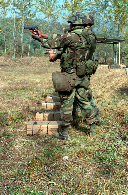 Members of Headquarters Battery, 12th Marines, fire 9mm M-9 Beretta pistols during the joint Korean-U.S. Exercise Bear Hunt '88