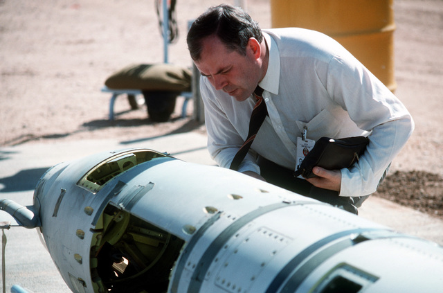 A Soviet inspector examines a BGM-109G Tomahawk ground launched cruise missile (GLCM) prior to its destruction.  Forty-one GLCMs and their launch canisters and seven transporter-erector-launchers are being disposed of at the base in the first round of reductions mandated by the Intermediate Range Nuclear Forces Treaty