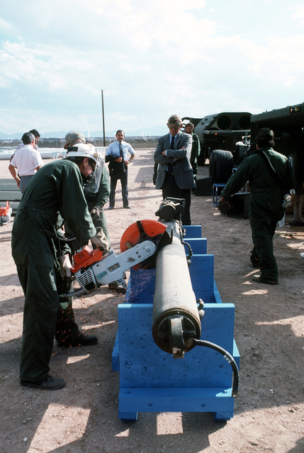 A worker uses a circular saw to destroy a component of a ground launched cruise missile (GLCM) transporter-erector-launchers (TEL).  Forty-one GLCMs and their launch canisters and seven TELs will be disposed of at the base in the first round of reductions mandated by the Intermediate Range Nuclear Forces Treaty