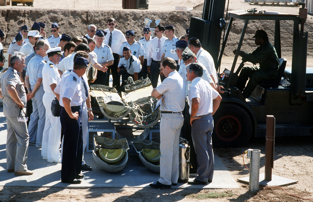 Members of the Soviet inspection team and their American escorts crowd around a forklift to view a BGM-109G Tomahawk ground launched cruise missile (GLCM) that was destroyed in accordance with the Intermediate Range Nuclear Forces Treaty.  Forty-one GLCMs and their launch canisters and seven transporter-erector-launchers will be disposed of at the base in the first round of reductions mandated by the treaty