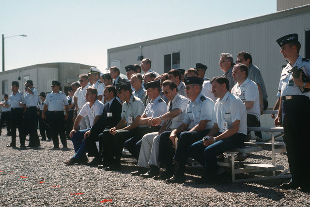 Members of the Soviet inspection team and their American escorts sit on some bleachers to view the destruction of ground launched cruise missile (GLCM) weapon systems under the terms of the Intermediate Range Nuclear Forces Treaty.  Forty-one GLCMs and their launch canisters and seven transporter-erector-launchers are being disposed of at the base in the first round of reductions mandated by the treaty