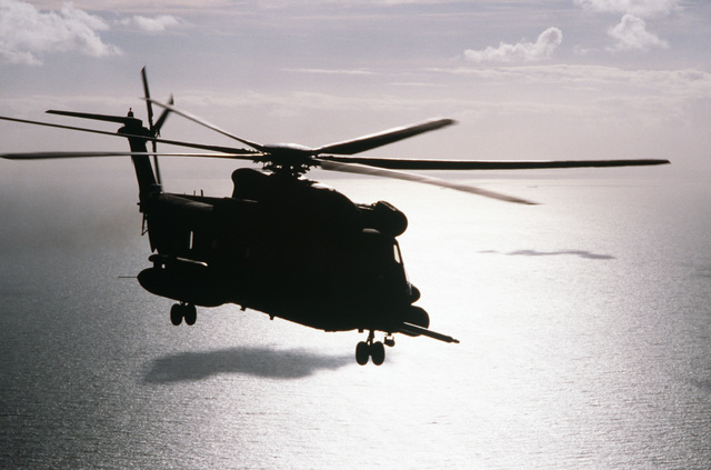 An MH-53J helicopter of the 21st Special Operations Squadron, equipped with the new Pave Low infrared system for night operations, flies low near the English coast