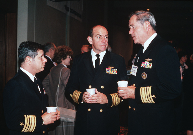 Vice Admiral (VADM) Jeremy M. Boorda, CHIEF of Naval Personnel, Deputy CHIEF of Naval Operations (Manpower, Personnel and Training), left, speaks with Vice Admiral (VADM) Richard M. Dunleavy, Commander, Naval Air, US Atlantic Fleet; and Vice Admiral (VADM) Joseph S. Donnell, III, Commander, Naval Surface Forces, US Atlantic Fleet, during the 1988 Navy-Marine Corps Family Support Conference held in Norfolk, Virginia