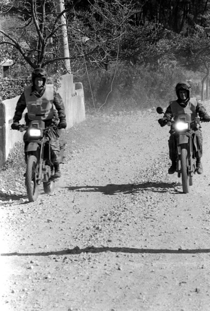 Members of the 3rd Battalion, 6th Marine Regiment, move out on motorcyels to confront aggressor forces during Operation Valiant Blitz '88