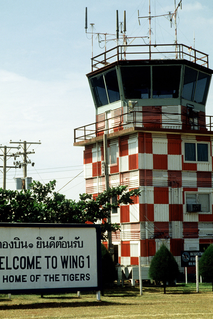 A welcome sign is posted beside the main control tower at Korat Royal Thai Air Base during Exercise CHECKERED FLAG