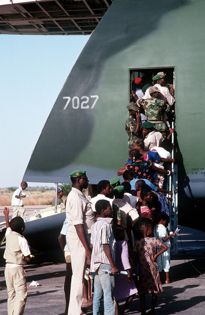 After its cargo of medical supplies, humanitarian aid, has been unloaded from the C-5 Galaxy, local residents and soldiers tour the giant aircraft