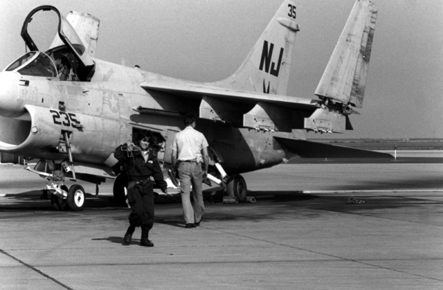 AIRMAN Grisselle Martinez finishes a routine maintenance inspection on an A-7 Corsair II aircraft