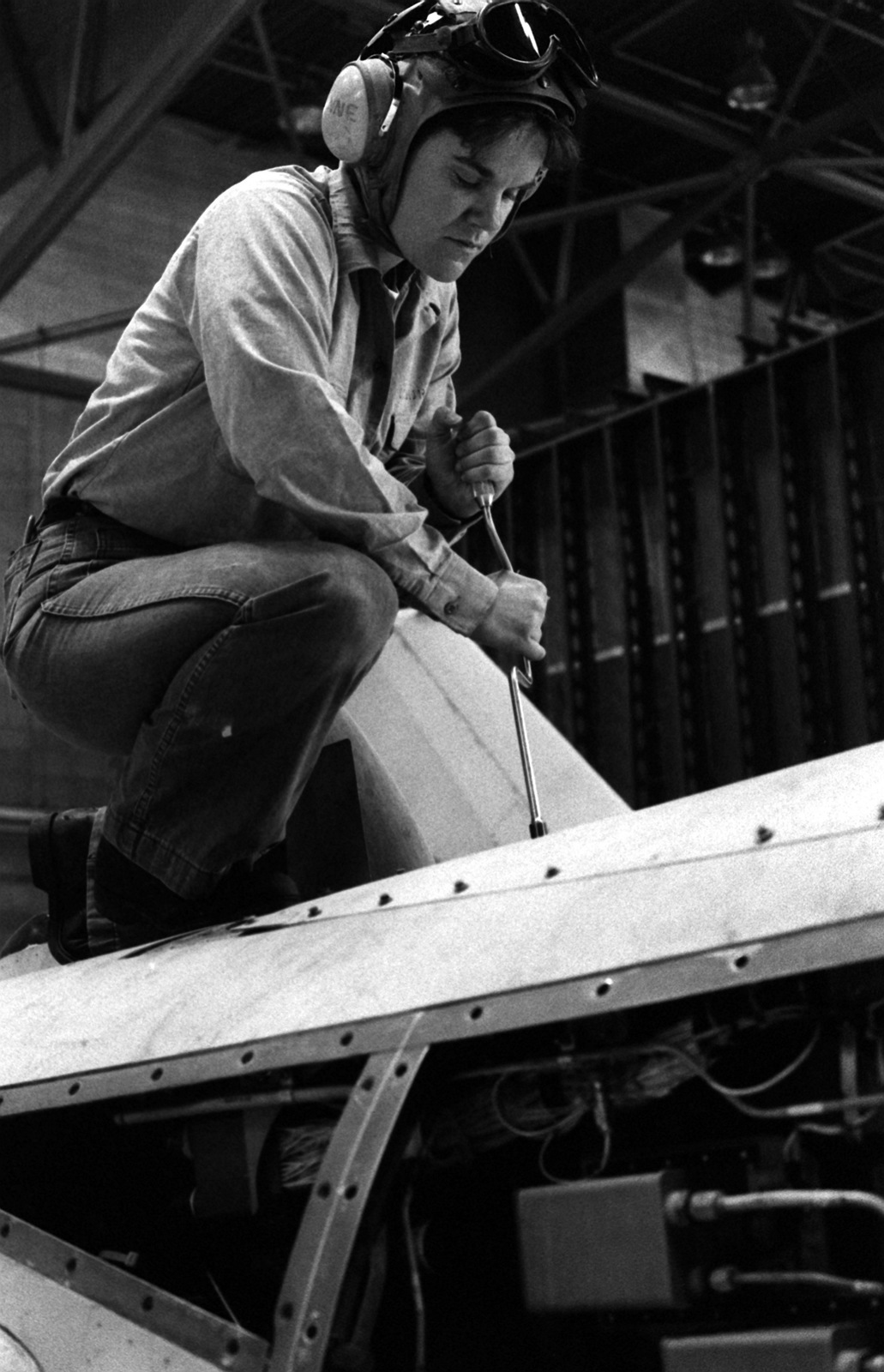 Aviation Structural Mechanic H AIRMAN Lynne Courtney rigs the flap system on the wing of an A-7 Corsair II aircraft