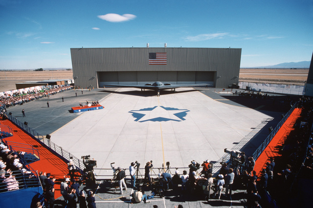 Spectators attend the roll out ceremony for the introduction of the B-2 advanced technology bomber on the flight line in front of Air Force Plant 42