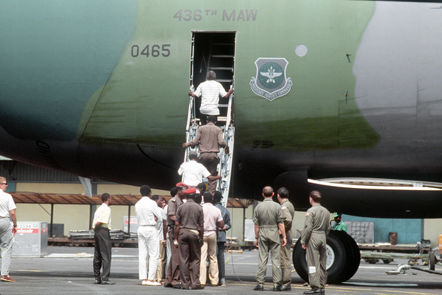 Local residents take the opportunity to tour a C-5A Galaxy aircraft from the 9th Military Airlift Squadron, 436th Military Airlift Wing. The aircraft has just deleivered several tons of humanitarian supplies and will be flying on to Chad to drop off the r