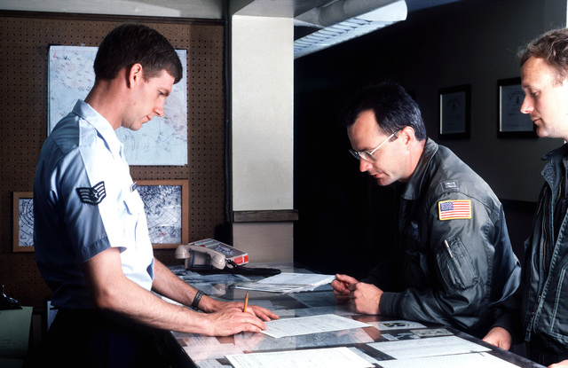 STAFF Sergeant Frank Kielnecker, a weather forecaster with the 11th Weather Squadron, Detachment 1, briefs C-130 Hercules aircraft pilots. Elmendorf is one of the few Air Force bases with observers who monitor the weather continuously, because of hard-to-predict fog and other severe conditions
