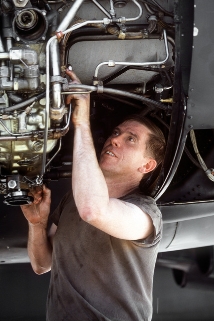 TSGT Bob Kirby of the 5th Organizational Maintenance Squadron repairs an engine of a B-52 Stratofortress bomber aircraft