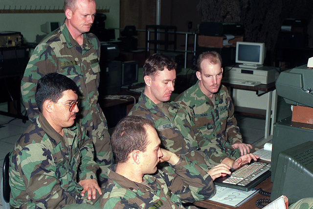 Five students in the Basic Computer Systems Operator Course learn battlefield automatic systems at the Army's new Computer Science School
