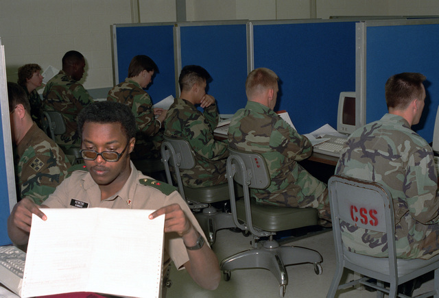 Students in the Basic Computer Systems Operator Course at the Army's new Computer Science School take a test.  In the left foreground is a visiting student from the armed forces of Djibouti
