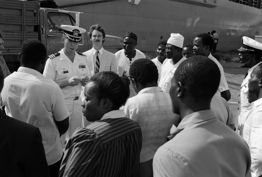 Commander (CDR) Hank Prevette, commanding officer of the tank landing ship USS SUMTER (LST 1181), gives a speech on Project Handclasp donations delivered by his ship.  The SUMTER is visiting Ivory Coast during a West African training cruise