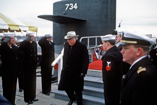 Side boys salute as Ned R. McWherter, governor of Tennessee, departs from the speakers platform following the commissioning ceremony for the nuclear-powered fleet ballistic missile submarine USS TENNESSEE (SSBN 734).  The TENNESSEE, which is being commissioned at the Naval Underwater Systems Center, is the first submarine equipped to carry the new Trident II D-5 missile