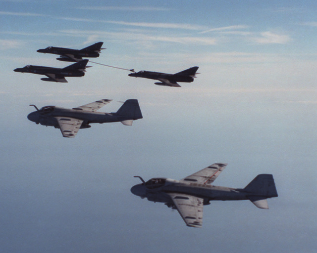 LT. CMDR. Leenhouts Eastern Mediterranean Sea....An air-to-air left side view of three French Etendard aircraft and two Attack Squadron 34 (VA-34) A-6 Intruder aircraft in an aerial refueling formation during exercise French Quarter '88. OFFICIAL U.S. NAVY PHOTO (RELEASED)
