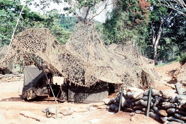 A camouflage net cover a command post tent in a fortified compound at a petroleum-oil-lubricants (POL) storage facility near Howard Air Force Base